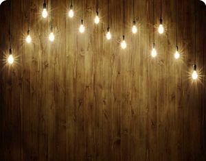 wood with string lights photo booth background