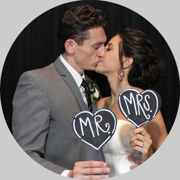 bride and groom kiss in photo booth