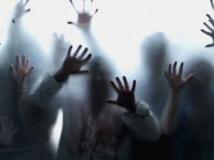 zombie hands pressed against window